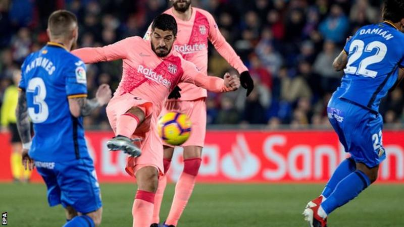 Messi and Suarez take Barcelona five points clear